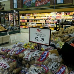 Photo taken at Mega Foods East by Carlos G. on 12/16/2011