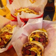 Photo taken at The Slaw Dogs by Reid M. on 2/28/2011