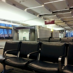 Photo taken at Concourse D by Alvaro C. on 12/7/2011