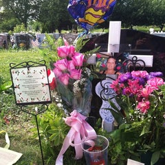 Photo taken at Lutheran-All Faiths Cemetery by Jenn McGowan R. on 6/18/2012