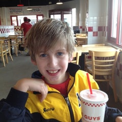 Photo taken at Five Guys by Ruth M. on 2/19/2012