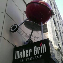 Photo taken at Weber Grill Restaurant by Nick B. on 4/12/2012
