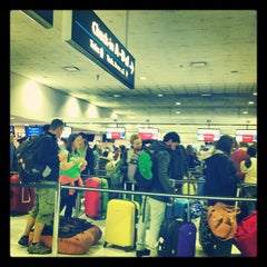 Photo taken at T1 International Terminal (SYD) by James C. on 7/3/2012