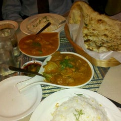 Photo taken at Taste of India by Marie L. on 12/20/2011