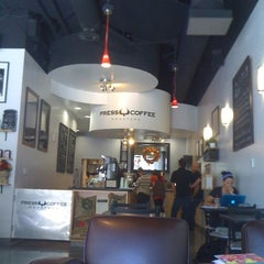 Photo taken at Press Coffee Roasters by Randy D. on 10/13/2011