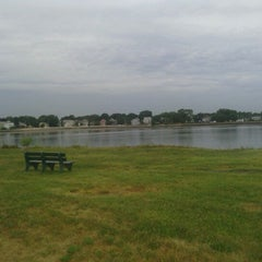 Photo taken at Collins Cove Beach by Karianne B. on 7/26/2012
