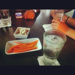 Photo taken at Words Cafe by Julien on 7/25/2012