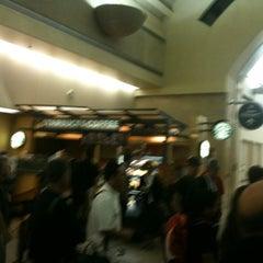Photo taken at Gate 12 by Bachan A. on 10/3/2011