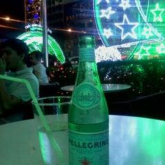 Photo taken at Cafe Central Nguyen Hue by Sophie L. on 1/2/2012