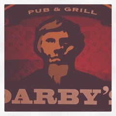 Photo taken at Darby's Pub and Grill by Scott D. on 12/1/2011