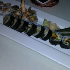 Photo taken at Moshi Sushi Bar by Brittany H. on 1/30/2012