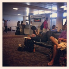 Photo taken at Terminal 4, Concourse B by Jessica B. on 6/24/2012