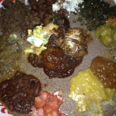 Photo taken at Bayu's Authentic Ethiopian Cuisine by Marlowe on 4/1/2012
