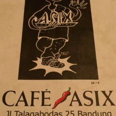 Photo taken at Cafe Asix by Dion D. on 12/29/2011