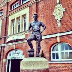 Photo taken at The Johnny Haynes Statue by Alexander B. on 7/14/2012