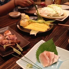 Photo taken at 焼鶏 松本 by Teppei M. on 8/28/2012