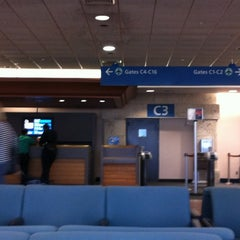 Photo taken at Concourse C by Anabel G. on 6/16/2012