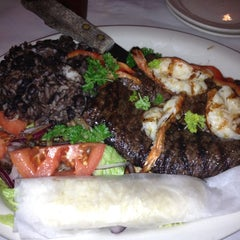 Photo taken at El Puerto Argentinean Grill by Sylvia M. on 9/7/2012