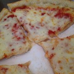 Photo taken at Leone's Pizzeria by Rachel L. on 3/9/2012