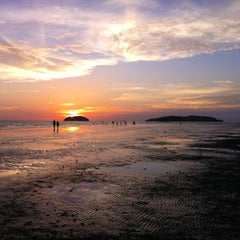 Photo taken at Tanjung Aru 1st Beach by Valerie S. on 9/2/2012