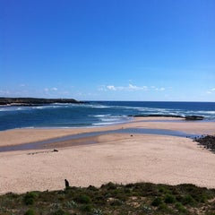 Photo taken at Praia de Vila Nova de Milfontes by Smmac on 4/30/2012