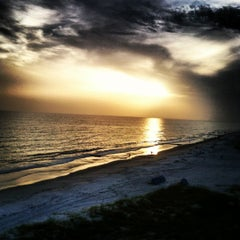 Photo taken at Madeira Beach by Eric B. on 6/10/2012