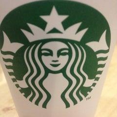 Photo taken at Starbucks by Ludmila V. on 2/13/2012