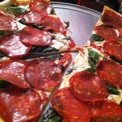 Photo taken at South Brooklyn Pizza by Charles B. on 2/10/2012