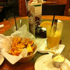 Photo taken at Olga's Kitchen by Tiffany K. on 2/15/2012