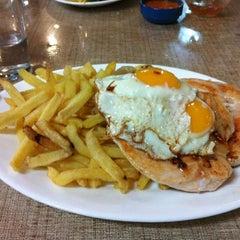 Photo taken at Restaurant La Motoneta by Julio C. on 5/8/2012