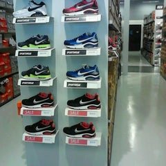 Photo taken at Nike Factory Store by Nikkip L. on 8/15/2012