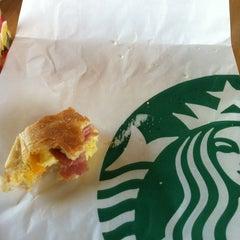 Photo taken at Starbucks by Claudia T. on 8/26/2012