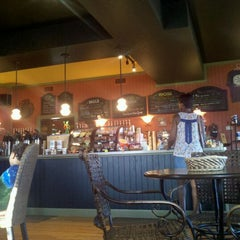Photo taken at Dancing Turtle Coffee Shop by Ron D. on 7/14/2012