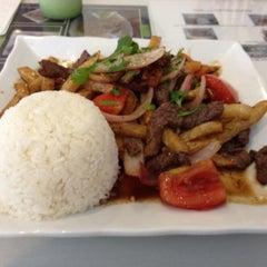 Photo taken at Mamita Peruvian Restaurant by mikee on 5/23/2012
