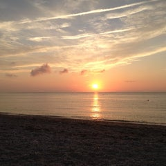Photo taken at Southold Beach by Byron B. on 8/4/2012