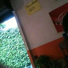 Photo taken at Los Cuñados by Erika N. on 8/18/2012