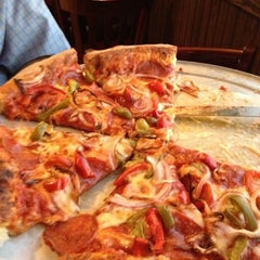 Photo taken at Lucianos Italian Brick Oven by Erica D. on 8/2/2012