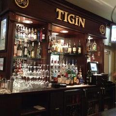 Photo taken at Tigín Irish Pub & Restaurant by Clint W. on 3/24/2012