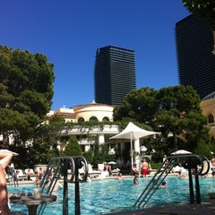 Photo taken at The Pool At Bellagio by Marita K. on 5/18/2012