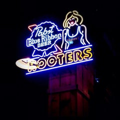 Photo taken at Hooters of Gaslamp by Leonardo P. on 7/16/2012