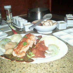 Photo taken at The Melting Pot by Bright Lights on 2/14/2012