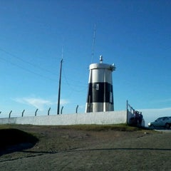 Photo taken at Farol do Morro dos Conventos by Tatiane B. on 4/8/2012