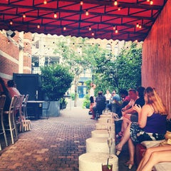 Photo taken at The Yard at SoHo Grand Hotel by Bergdorf Goodman on 8/31/2012