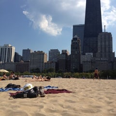 Photo taken at Oak Street Beach by Trystan T. on 8/24/2012