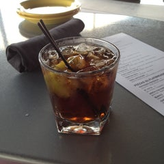 Photo taken at Rumba Rum Bar & Satay Grill by Meghan C. on 8/23/2012