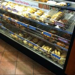 Photo taken at Einstein Bros Bagels by Heather R. on 6/21/2012