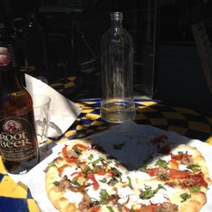 Photo taken at Pizzetta 211 by Russell H. on 6/26/2012