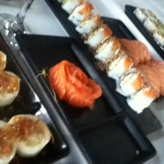 Photo taken at SushiClub by Fer A. on 8/11/2012