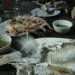Photo taken at ร้านอีสานพัฒนา (ปากหมา) by Tawanrung N. on 9/12/2012