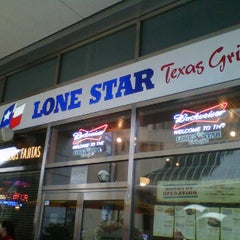 Photo taken at Lone Star Texas Grill by Sare K. on 7/13/2012
